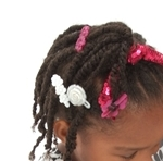 Little girls natural hair style, two strand twist with ponytail